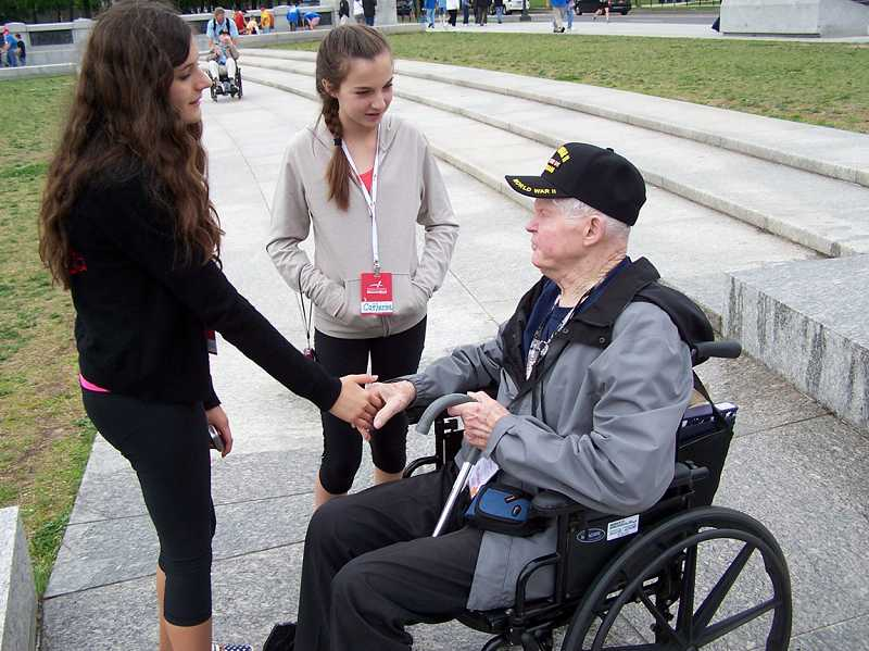 by: STEVE HILL/FOR THE REGAL COURIER - LOTS OF ACTIVITIES -Well-wishers greet veteran Marion Hill at the WWII Memorial in Washington, D.C., where Freedom Wall has more than 4,000 gold stars representing dead or missing troops.
