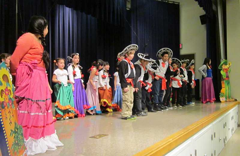 by: BARBARA SHERMAN - TAKE A BOW - A group of Deer Creek students takes a bow after performing several Mexican dances in front of the student body Feb. 28, which was a prelude to another performance in front of parents that evening.