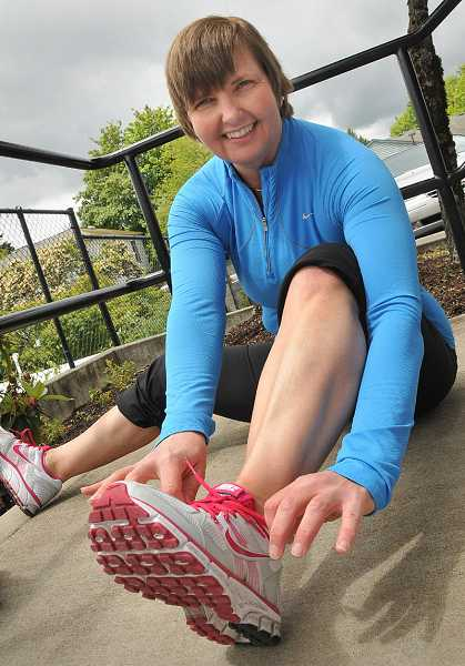 by: VERN UYETAKE - Duback laces up her shoes for yet another long run.