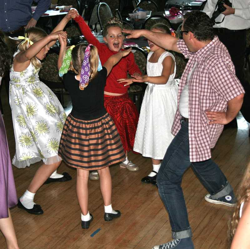 by: J. BRIAN MONIHAN - A group of girls and a dad bust a move at the dance June 15, which was held at the Sunset Fire Hall.