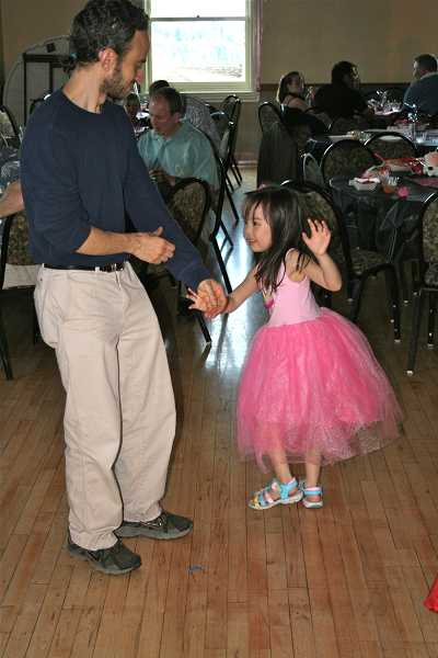by: J. BRIAN MONIHAN - A happy duo cut a rug during the annual Daddy-Daughter Dance.