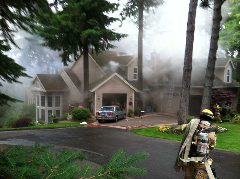 by: LOFD - This is the front of a house off of Woodland Terrace right after a victim was removed from roof above the garage.
