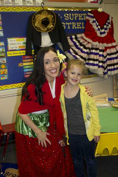 Spanish immersion kindergarten teacher Raquel Vasquez, who organized a Cinco de Mayo celebration, poses with student Emma Carnese.