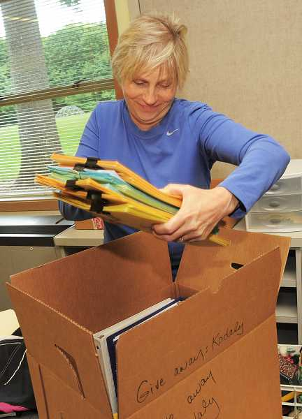 by: VERN UYETAKE - Music instructor Cindy Christensen packs up some of her personal items in her classroom at Uplands.