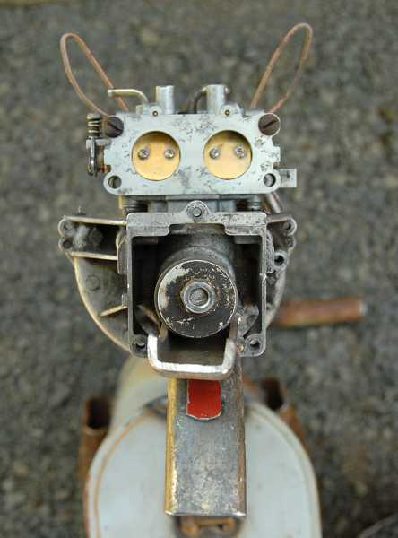 by: VERN UYETAKE - A small carburetor and engine acts as the coyoteâs head, a piston makes its nose and a mailbox flag forms its tongue.