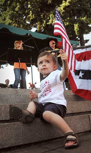 by: VERN UYETAKE - A youngster at last year's Fourth of July celebration enjoyed watching the parade.