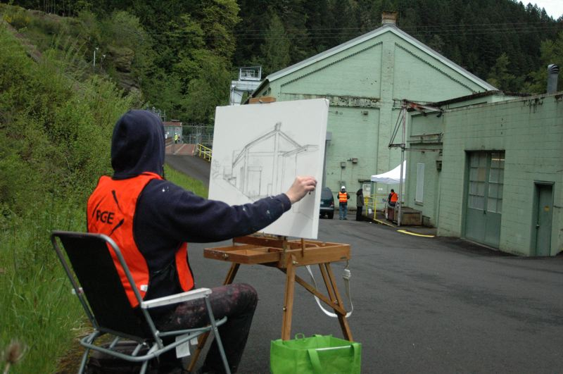 by: JEFF SPIEGEL - Portland artist Chris Mooney sketches the outside of the powerhouse as part of his research.