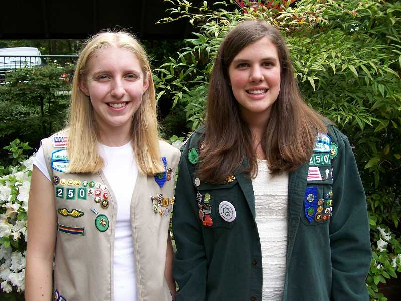 by: SUBMITTED -  Kara Brown, left, and Cassie Hansen received their Girl Scout Gold Awards at a ceremony held June 3. The Gold Award is the highest honor given in Girl Scouting.