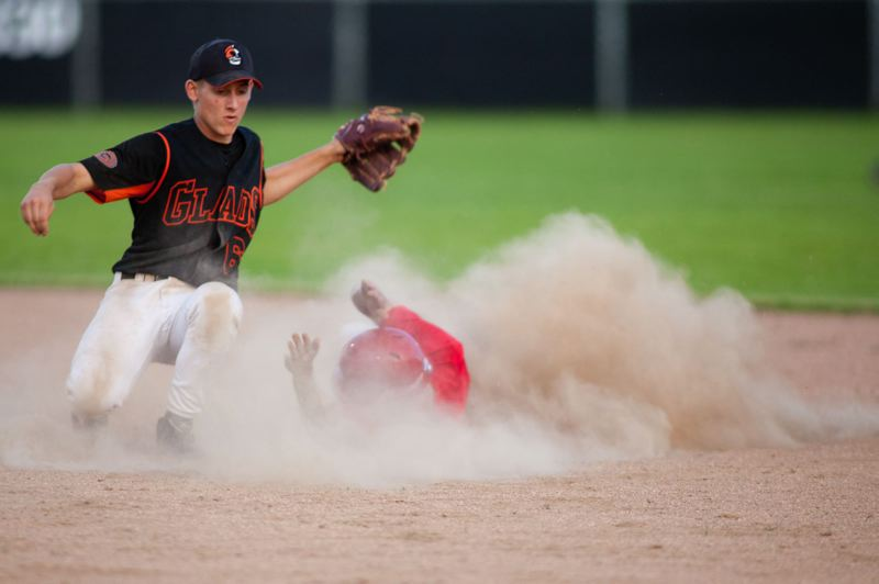 by: MEG WILLIAMS - Gladstone shortstop A.J. Swalko makes the tag on an Estacada baserunner for an out in last week's 5-4 win over the Rangers. Gladstone entered play this week with a record of 8-3 in Junior State Baseball.