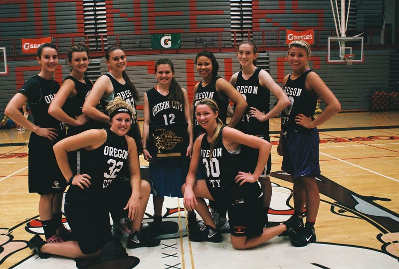 Oregon City Black players pose proudly with their first place hardware from the recent End Of The Oregon Trail River City Classic Basketball Tournament. Pictured are (front, from left) Johanna Paine and Jamie Goff; and (back) Jenae Paine, Jessica Gertz, Catelyn Preston, Montana Walters, Tiani Bradford, Chelsi Brewer and Amber Fifield.