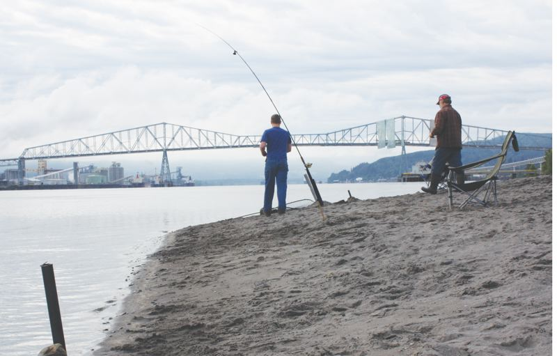 by: KATIE WILSON - Fishermen cast off at Dibblee Point near Rainier. The 110-acre site is owned by the Oregon Department of State Lands and has never officially been designated as a recreation area although people flock there to fish and picnic.