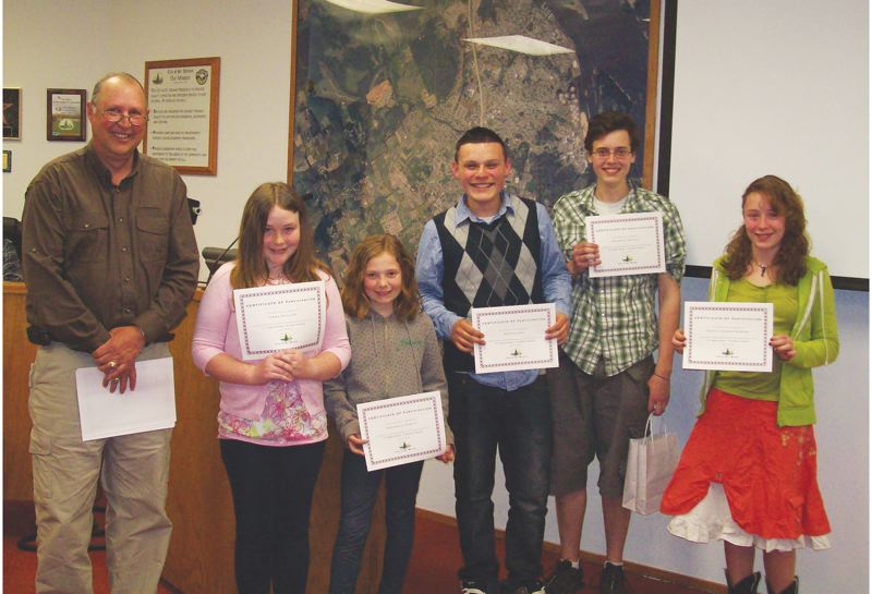 by: COURTESY PHOTO - St. Helens Mayor Randy Peterson (far left) presents certificates to (left to right) Emma Phillips, Anabelle Robitz, Nathan Don, Nicholas Troiano and Trinyty Farmer-Howard for their participation in the 'If I Were Mayor' contest at the May 2 city council session.