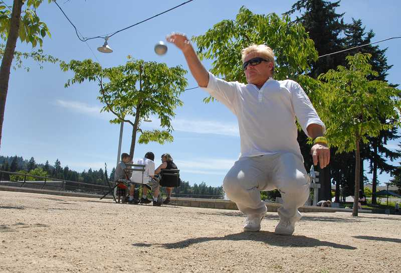 by: REVIEW, TIDINGS PHOTO: VERN UYETAKE - Johnny Prince was born in France, grew up in France and now he is the father of petanque in Lake Oswego.