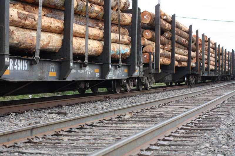 by: KATIE WILSON/THE SPOTLIGHT - A log train travels through St. Helens July 2. Congress voted forward a one-year extension of federal timber payments last week, which will help bolster rural county budgets, albeit temporarily.