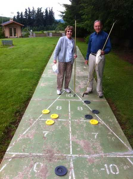 by: SUBMITTED - Vera Young and Bob Graham send the biscuit on a nice afternoon at the West Linn Adult Community Center.
