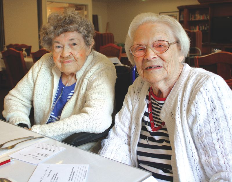 by: KATIE WILSON/PAMPLIN MEDIA GROUP - Evelyn Sasseen (left) and Mary Marcinko (right) regularly eat lunch together at the Avamere senior care facility in St. Helens. The women celebrated a shared milestone when they both turned 100 on June 9.