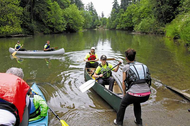 by: JONATHAN HOUSE - Boaters returned to shore at Tualatin Community Park, where festive activities awaited families.