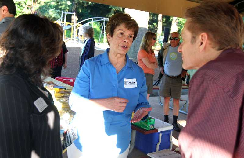 by: JONATHAN HOUSE. - Jan Giunta chats with supporters at Tualatin Community Park after her announcement June 27 to run for City Council. 'The City Council needs to be more open and transparent,' Giunta says.
