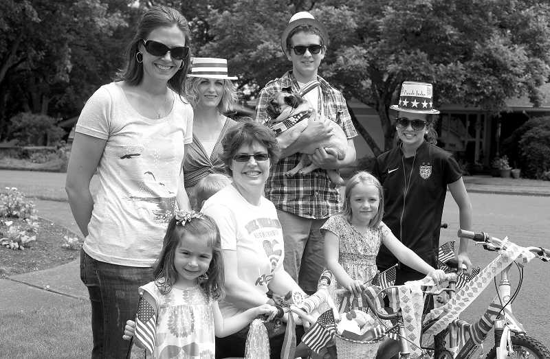 by: JONATHAN HOUSE - From top left, Annie Miller, Marisa Henrie, Matthew Staropoli (with Caesar), Laura Staropoli, bottom left, Avery Miller, Simon Henrie, Kimarie Wolf, and Lola Henrie are the main organizers of the Royal Woodlands Children's Fourth of July Parade this year.