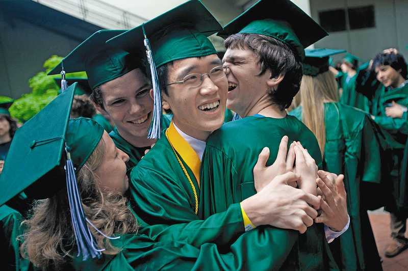 by: CHRISTOPHER ONSTOTT - Henry Li (center), a Harvard-bound Wilson High graduate, gets a group hug from friends Elise Barberis (left), Jack Lloyd and Lloyd Lewins (right) at graduation.