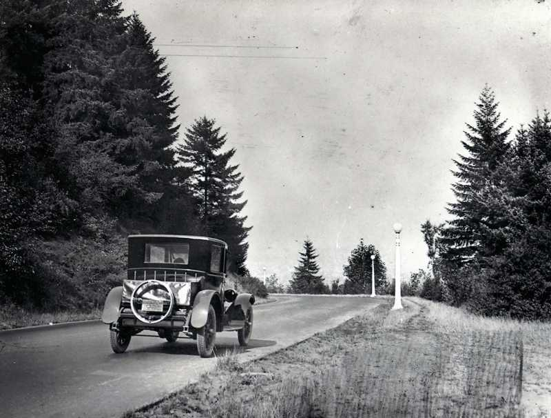 by: SUBMITTED PHOTO - A car drives through Terwilliger Parkway in 1914.