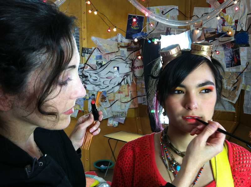 by: SUBMITTED PHOTO - Celena Rubin, left, puts the finishing touches on a models makeup.