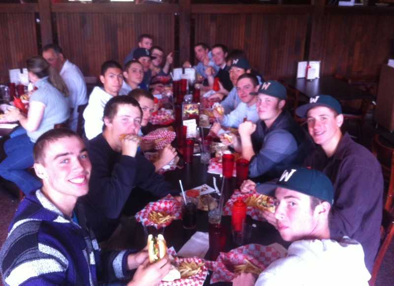 by: SUBMITTED PHOTO - One week after winning the state 5A baseball championship, Joe Rapport of Joe's Burgers in Raleigh Hills treated the Wilson High School team to lunch before it started its summer season.