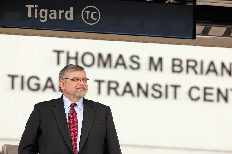 by: CHRISTOPHER ONSTOTT, STAFF PHOTOGRAPHER - Tom Brian, former legislator and Washington County Commission chair stands at the Tigard Transit Center that bears his name in 2011. Brian was recently named the Heart of Washington County award winner for his years of public service.