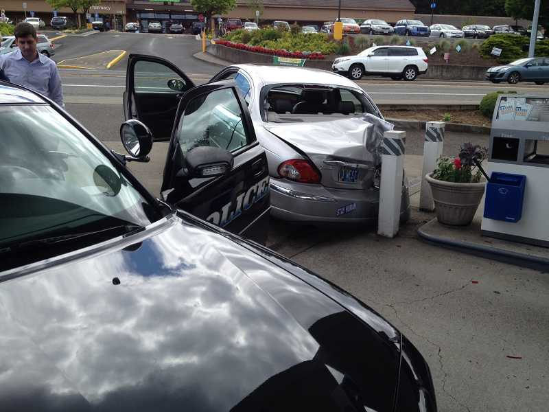by: WEST LINN POLICE DEPARTMENT - This vehicle rolled from the Walmart parking lot and crashed into a pole at the Chevron gas station.