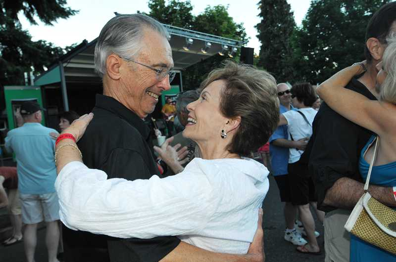 by: VERN UYETAKE - West Linn Mayor John Kovash and his wife, Merle, share a dance during West Linn's 2010 street dance.