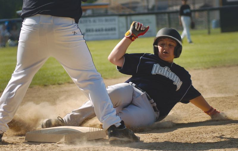 by: THE OUTLOOK: DAVID BALL - Greshams Greg Mehlhaff slides safely into third base and would eventually score in the fifth inning of Tuesdays win over Reynolds.