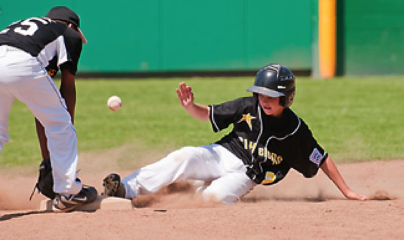 SPOTLIGHT PHOTO: JEREMY DUECK St. HelensÄô Drake Dow slides into second during the opening round of the Little League All-Stars Tournament this past weekend at Riverside.