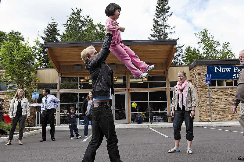 by: JAIME VALDEZ - Daniel Baker lifts 5-year-old Maylia Kaholo of Tualatin, showing her what it's like to be the dance partner of a professional ballet dancer. Baker was at Smiles Northwest in Beaverton on Tuesday.