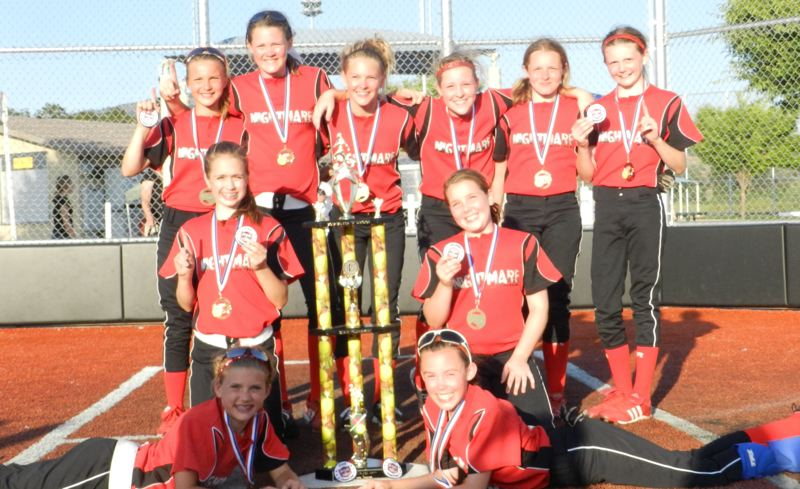 by: SUBMITTED PHOTO - Oregon City Nightmare players pose proudly with their championship medals and trophy from the Oregon Amateur Softball Association 12-B State Tournament. Pictured are: (front, from left) Allie Edwards and Callie Blanchard; (second row) Hannah Sisul and Makenzie Chambers; and (back) Emily Dugan, Morgan Hornback, Aubree Schrandt, Liberty Robinson, Zoe Munn and Camryn Williams.