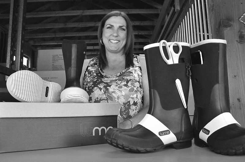 by: VERN UYETAKE - These boots are made for walking and also carrying stuff. Wrayann Estey is excited about launching Lume Footwear at the West Linn Old Time Fair.