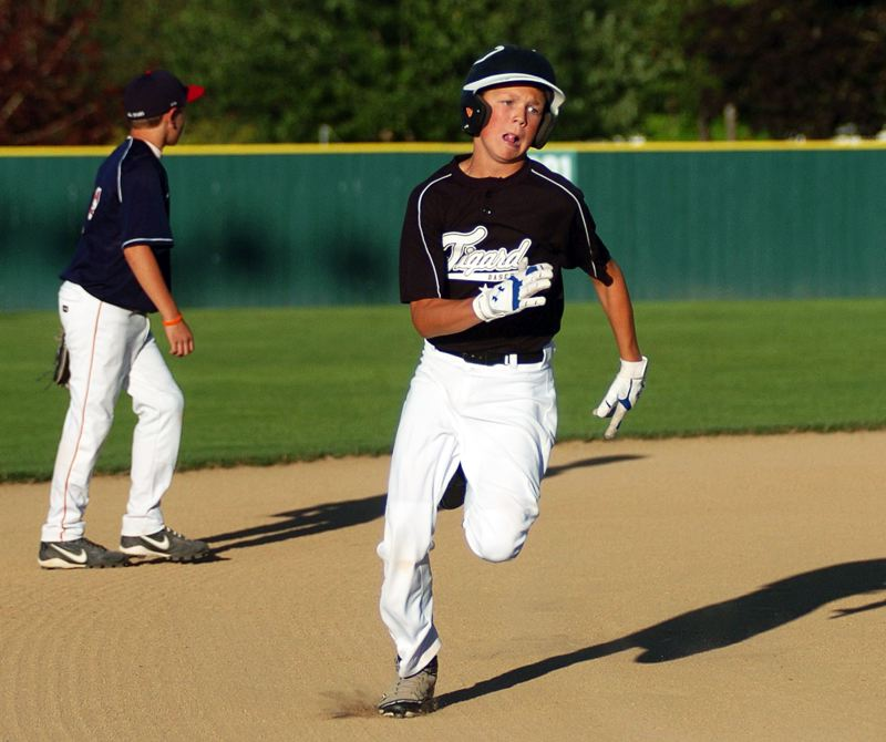 by: DAN BROOD - ROUNDING THE BASES -- Tigard's Nicholas Heinke sprints past second base and heads to third on his way to scoring a first-inning run in the team's 11-3 win over Beaverton in the District 4 quarterfinal game.