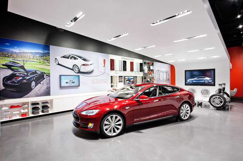 The new Tesla Motoros showroom opens Friday with a model of its 300-mile-range all-electric car on display.