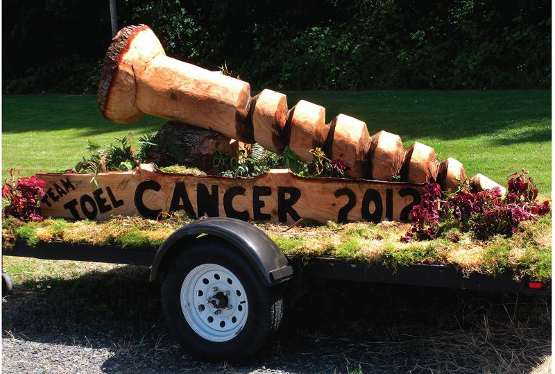 by: STAFF PHOTO BY JIM HART - This huge screw was carved out of a tree by Scott Lundeen to symbolize Joel Barbers attitude toward the disease that ultimately took his life in April. The screw is now at the family home in Eagle Creek, and will become the centerpiece in a memorial at the home.