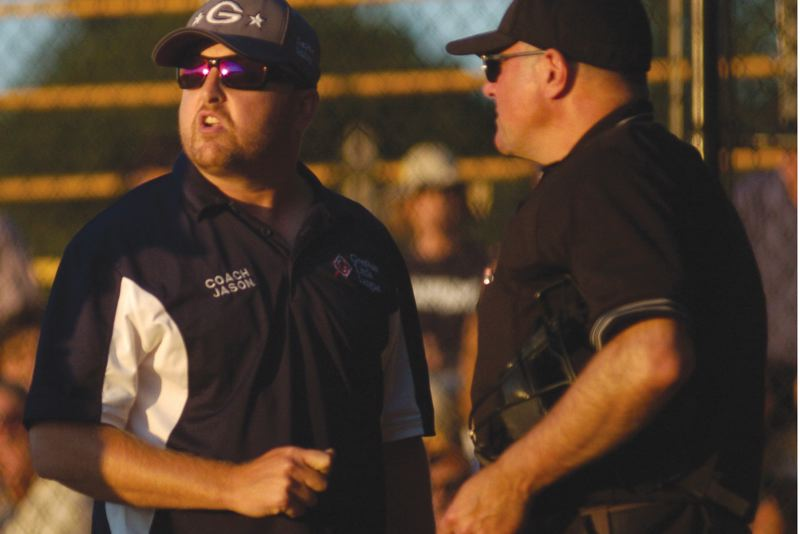 by: THE OUTLOOK: DAVID BALL - Gresham manager Jason Trickel appeals an umpires ruling late Tuesday night that eventually ended up taking Greshams go-ahead run away.