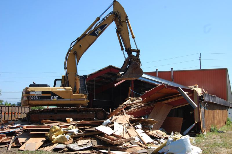 by: CONTRIBUTED PHOTO BY CITY OF GRESHAM - Crews this week demolished a vacant nursery building in the Rockwood area to make way for a new police facility funded as part of GreshamÄôs first urban renewal district. Construction is scheduled to start early next year.