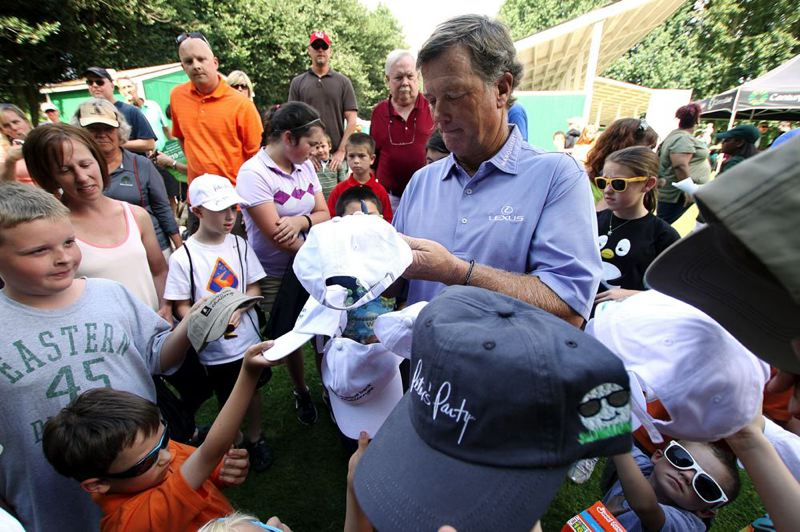 by: TRIBUNE PHOTO: ADAM WICKHAM - Golf pro Peter Jacobsen, who will play host to the Umpqua Bank Challenge Aug. 26-28 at The Reserve Vineyards and Golf Club in Aloha, signs autographs after a clinic at The Children's Course in Gladstone.