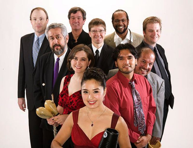 by: CONTRIBUTED PHOTO - The 10 members of Aguamiel have been producing spicy salsa music together for nearly a decade. They will bring their traditional and contemporary sounds to Sandy Wednesday, Aug. 8.