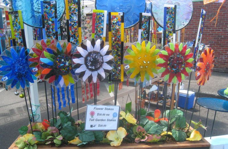 by: PHOTOS BY GLORIA POLZIN - Among the unique art items for sale in the art fair were these glass flower stakes.