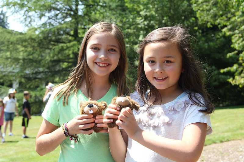 by: SUBMITTED PHOTO: CYDNY WINSLOW - Tiny teddy bears make Explorers Camp fascinating for two happy campers. The program going on this week at the West End Building covers subjects from fairy tales to space travel.