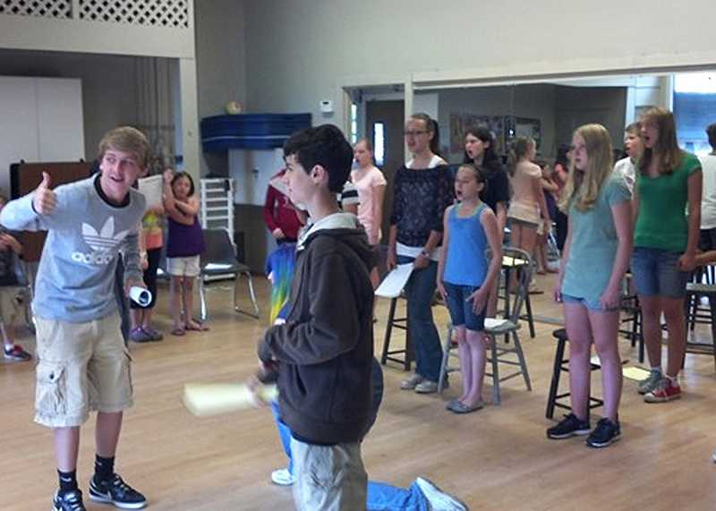 by: SUBMITTED PHOTO - SUBMITTED PHOTO Pictured left to right: Colton Lapp gives a thumbs-up to Aiden Savoy in rehearsal for the first session of Sleepy Hollow Children's Theatre at Lakewood Center for the Arts, which was held in July. A second session begins Aug. 6.