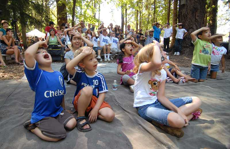 by: VERN UYETAKE - Children and adults alike are wowed by the entertainment at the Arts Festival in the Forest.