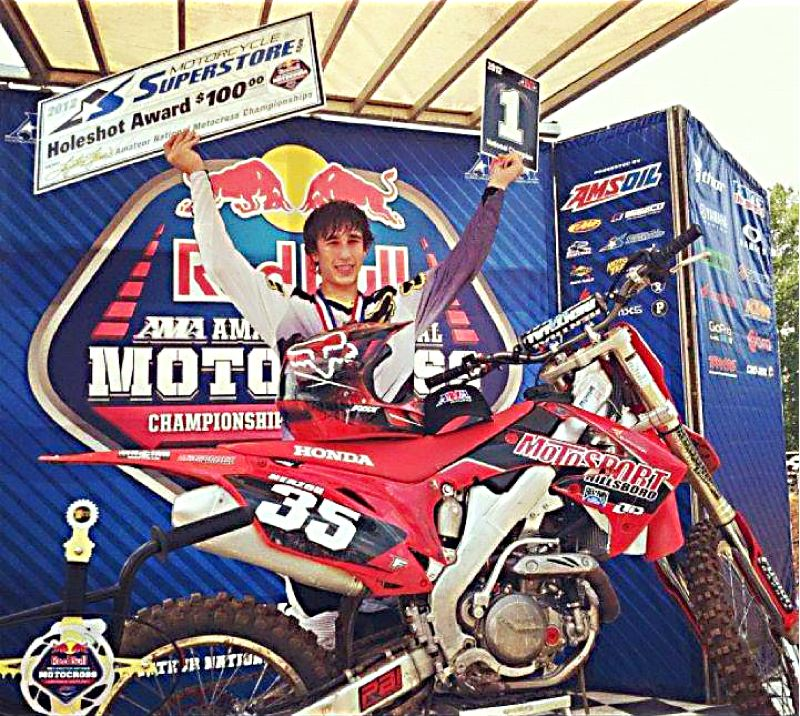 by: SUBMITTED PHOTO - Cody Herzog celebrates after winning the overall title in the 450cc C class at a national race in Tennessee. Herzog took first in all three races in his class.