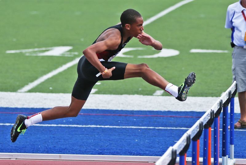 by: DAVID BLAIR - UP AND OVER -- Tigard Youth Track's Julian Body races through a heat of the high hurdles at the Junior Olympics National Championships in Baltimore, MD.