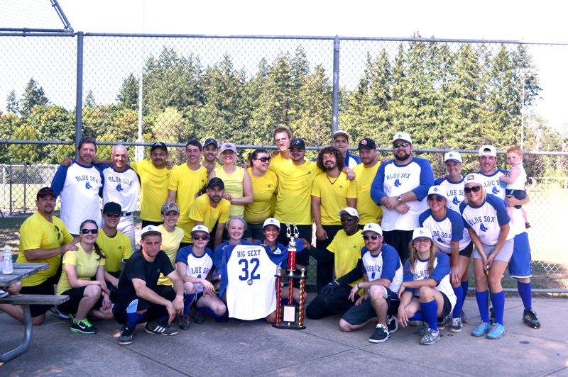 by: SUBMITTED PHOTO - PDXtreme, the Portland Airport Red Robin team, and the Blue Sox, the Gresham Station Red Robin team, shared this years title.