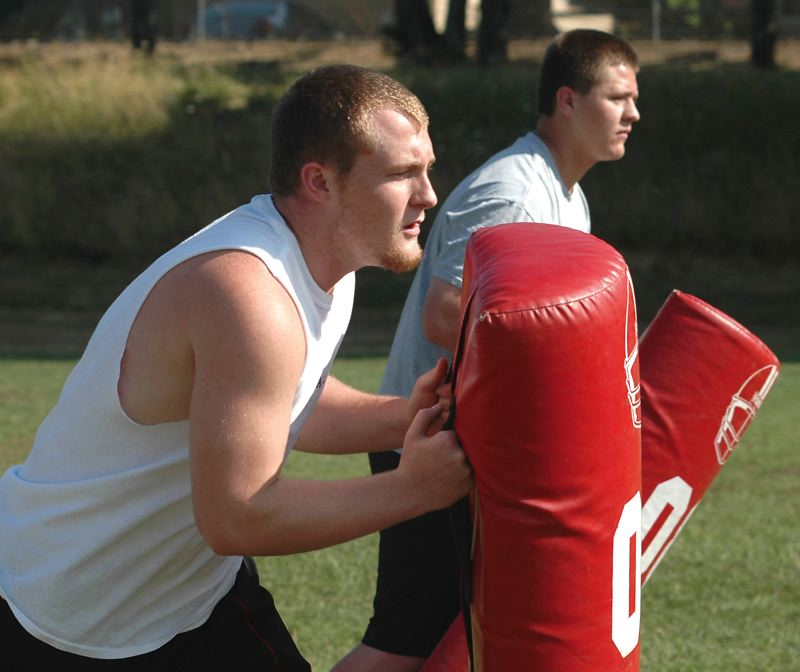 by: KRISTOPHER ANDERSON - Senior Kevin TenEyck, left, emerged as a leader on the offensive line during Sandys offseason weight training program. Incoming freshman Crafton Chamberlin, right, enters the program with much potential.
